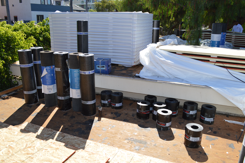 Energy efficient flat cool roof installation in san diego for Energy efficient roofing material