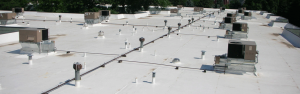 Commercial roof installation on flat roof