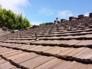 Cedar tile roofing materials installed
