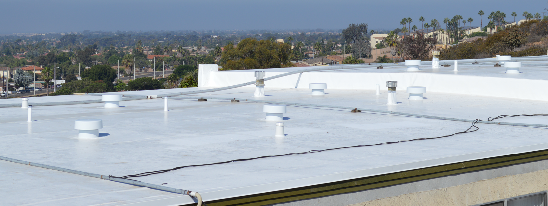 Commercial roofing with Cool Roof products